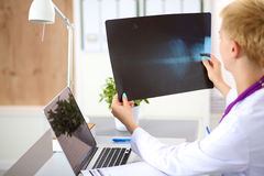 Confident female doctor examining accurately a rib Stock Photo
