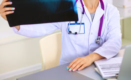 Confident female doctor examining accurately a rib Royalty Free Stock Photo