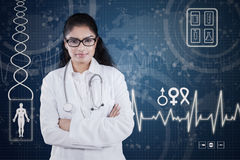 Confident female doctor with futuristic screen Royalty Free Stock Image