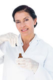 Confident female doctor holding medicine bottle Royalty Free Stock Photo