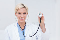 Confident female doctor holding stethoscope Royalty Free Stock Photography