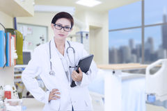Confident female doctor at hospital Royalty Free Stock Photography