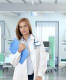 Confident female doctor in hospital room Stock Photo