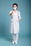 Confident female doctor or nurse wearing surgical mask Royalty Free Stock Photography