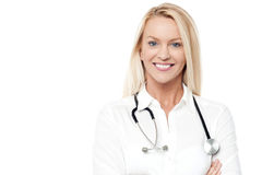 Confident female doctor over white. Beautiful female physician with folded arms Stock Photos
