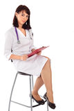 Confident Female Doctor Sitting on Chair Royalty Free Stock Images