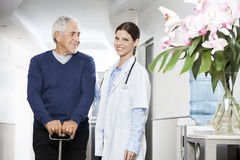 Confident Female Doctor Standing With Senior Man Royalty Free Stock Photos