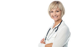 Confident female doctor with stethoscope. Female surgeon with stethoscope around her neck Stock Photography