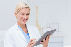 Confident female doctor using digital tablet Stock Photography