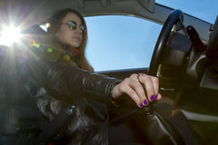 Confident female driver Stock Images