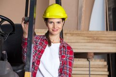Confident Female Engineer Wearing Hardhat By Stock Photos