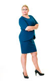 Confident female executive in blue dress on white Stock Photo