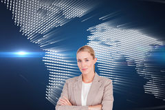 Confident female executive with folded arms Royalty Free Stock Photos