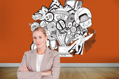 Confident female executive with folded arms Stock Image