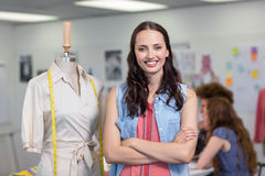 Confident female fashion designer with arms crossed Stock Photos