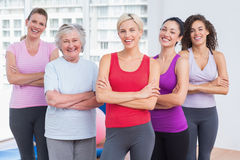 Confident female friends standing arms crossed Royalty Free Stock Image