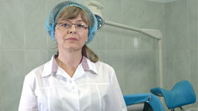 Confident female gynecologist in glasses looking at the camera stock video