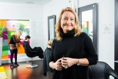 Confident Female Hairdresser Holding Scissor Royalty Free Stock Photo