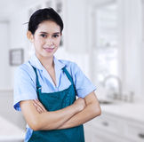 Confident female housekeeper. Portrait of female housekeeper. shooting in the kithcen Royalty Free Stock Photos