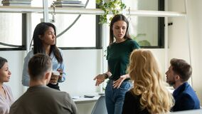 Free Confident Female Leader, Mentor Holding Briefing For Multiracial Team Workers. Royalty Free Stock Photo - 181554405