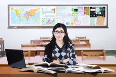 Confident female learner posing in the class Stock Photo