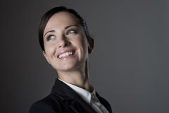 Confident female manager posing on dark background Royalty Free Stock Images