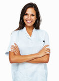 Confident female nurse smiling with arms crossed Stock Photo