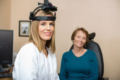 Confident Female Optometrist With Senior Patient Royalty Free Stock Images