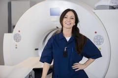 Confident Female Radiologist By MRI Machine Stock Image