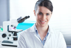 Confident female researcher in the chemistry lab stock image