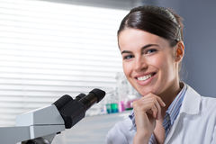 Confident female researcher in the chemistry lab Stock Photo
