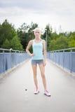 Confident female runner having her break after running Stock Photos