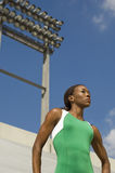Confident Female Runner In Stadium Stock Image