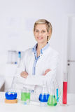 Confident Female Scientist With Arms Crossed Standing At Desk Stock Image