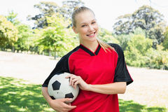Confident female soccer player at park Royalty Free Stock Photo