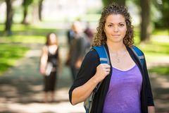 Confident Female Student Standing At Campus Stock Photos