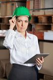 Confident Female Supervisor With Digital tablet At Royalty Free Stock Image