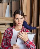 Confident Female Supervisor Holding Clipboard Royalty Free Stock Image