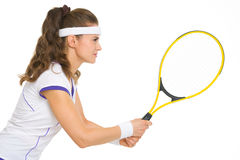 Confident female tennis player in stance Royalty Free Stock Photos