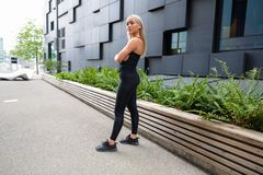 Confident Female Urban Runner Standing With Her Arms Crossed royalty free stock photo