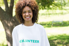 Confident female volunteer in park Royalty Free Stock Images