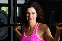 Confident Female Weight Lifter Stock Photography