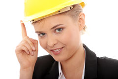 Confident female worker in helmet Stock Photo