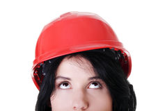 Confident female worker in helmet looking up Royalty Free Stock Images