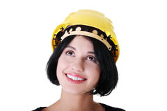Confident female worker in helmet looking up Royalty Free Stock Photo