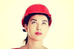 Confident female worker in helmet looking up. Stock Image
