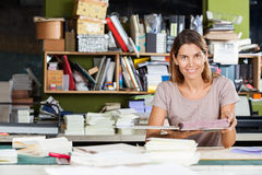 Confident Female Worker Holding Spiral Book In Stock Photography