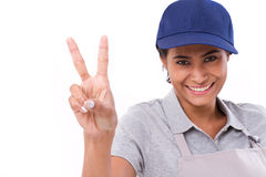 Confident female worker showing 2 finger gesture Royalty Free Stock Images