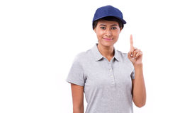 Confident female worker showing one finger gesture. Confident female worker showing one finger hand gesture Stock Images