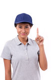Confident female worker showing one finger gesture. White isolated background Stock Photo